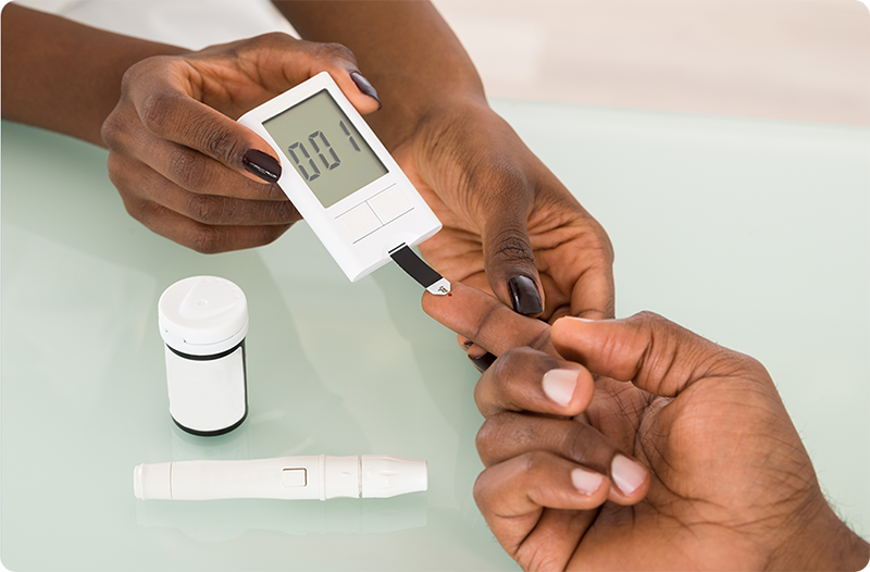 Patient having their blood sugar level checked