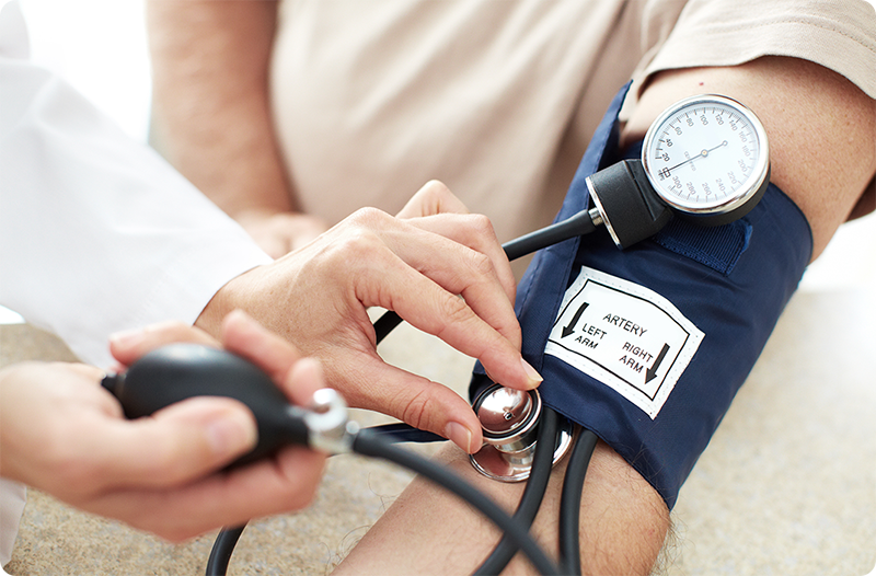 Provider checking a patient's blood pressure